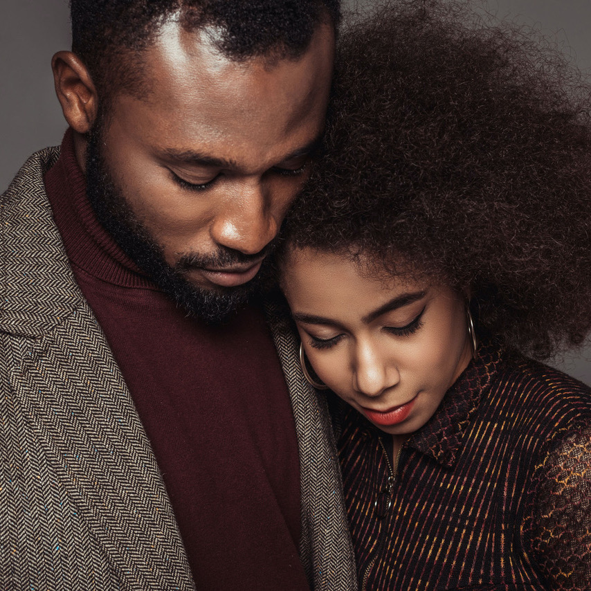 african american retro styled couple hugging isolated on grey