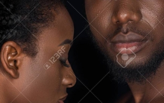 beautiful young african american couple with water drops on faces posing isolated on black